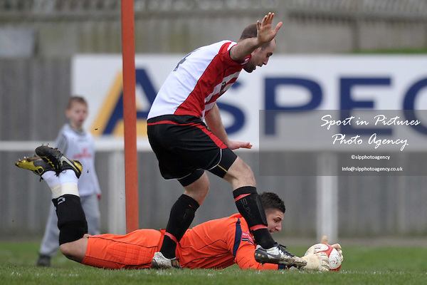 Darren Behcet (Hornchurch goalkeeper) saves at the feet of Elliot Styles (Hornchurch captain). AFC Hornchurch Vs Croydon Athletic. Ryman Premier League. The Stadium. Essex. 05/03/2011. MANDATORY CREDIT Sportinpictures/Garry Bowden