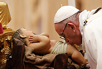 Pope Francis kisses the statuette of Baby Jesus at the beginning of the Christmas Eve mass in St. Peter's Basilica, Vatican, 24 December 2017.<br /> UPDATE IMAGES PRESS/Riccardo De Luca<br /> <br /> STRICTLY ONLY FOR EDITORIAL USE
