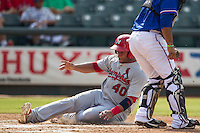 Memphis Redbirds catcher Audry Perez (40) slides safely home during the first game of a Pacific Coast League doubleheader against the Round Rock Express on August 3, 2014 at the Dell Diamond in Round Rock, Texas. The Redbirds defeated the Express 4-0. (Andrew Woolley/Four Seam Images)