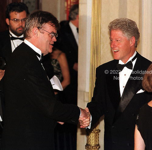 Washington, DC - September 29, 1999 -- U.S. President Bill Clinton welcomes Garrison Keillor, one of the recipients of the 1999 National Humanities Medal to the White House in Washington, DC on 29 September, 1999..Credit: Ron Sachs / Pool via CNP