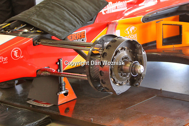 Indy car brakes get inspected during qualifying for the IZOD Indycar Firestone 550 race at Texas Motor Speedway in Fort Worth,Texas.