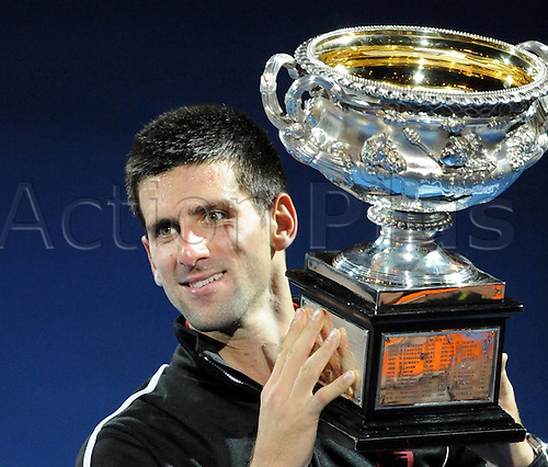 29 01 2012   Melbourne  Novak Djokovic of Serbia poses with The winners Trophy during The Awards Ceremony for the  mens singles finals between Rafael Nadal and Novak Djokovic.