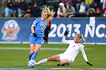 08 December 2013: UCLA's Samantha Mewis (22) and Florida State's Dagny Brynjarsdottir (ISL) (7). The Florida State University Seminoles played the University of California Los Angeles Bruins at WakeMed Stadium in Cary, North Carolina in a 2013 NCAA Division I Women's College Cup championship game.