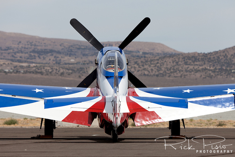 "P-51D Mustang ""Miss America"" sits on the tarmac during the 2012 Reno National championship Air Races at Stead Field in Nevada."