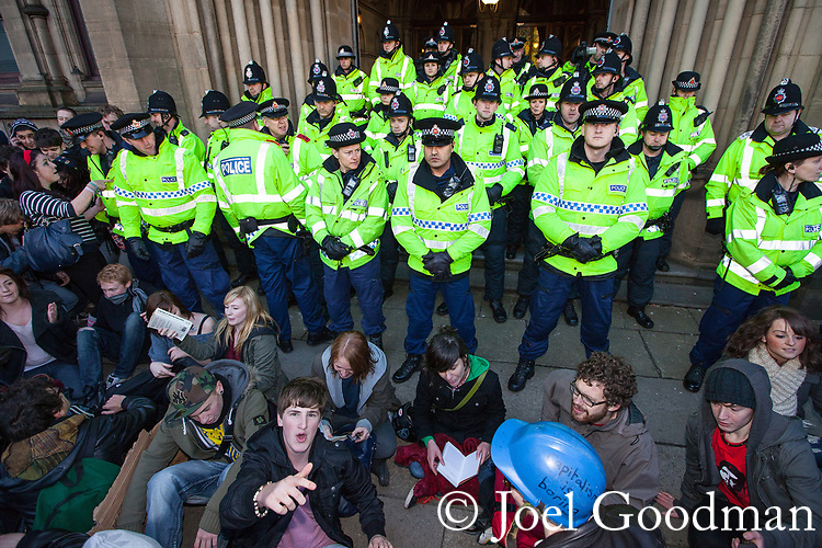 © Joel Goodman - 07973 332324 . 24/11/2010 . Manchester , UK . Police block the entrance to Manchester Town Hall to prevent protesters from accessing the building . Students and their supporters march and demonstrate through Manchester City Centre against government cuts to student support and rising education fees , specifically against an election pledge made by the Liberal Democrats prior to forming the coalition government . Photo credit : Joel Goodman
