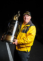 Nov 11, 2018; Pomona, CA, USA; NHRA official XXXX poses for a portrait with the championship trophy during the Auto Club Finals at Auto Club Raceway. Mandatory Credit: Mark J. Rebilas-USA TODAY Sports
