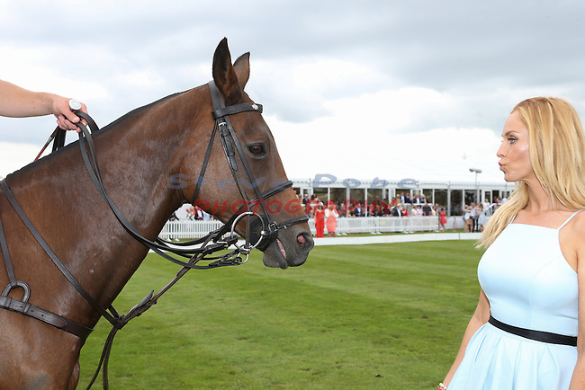 Josie Gibson gets up close and personal with a polo pony at Polo at the Manor<br /> Celtic Manor Resort<br /> 18.06.16<br /> &copy;Steve Pope <br /> Fotowales