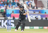 Kane Williamson (New Zealand) with a classical straight drive for four runs during India vs New Zealand, ICC World Cup Semi-Final Cricket at Old Trafford on 9th July 2019