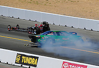Jul. 18, 2010; Sonoma, CA, USA; NHRA comp eliminator driver Brandon Huhtala (near) loses control and crashes alongside Dean Carter during the Fram Autolite Nationals at Infineon Raceway. Mandatory Credit: Mark J. Rebilas-