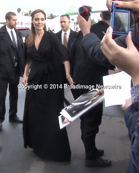 Pictured: Brad Pitt and Angelina Jolie<br /> Mandatory Credit &copy; Fernando Allende/Adriano Camolese/Broadimage<br /> Angelina Jolie gives spanks Brad's Pitt butt as they sign autographs in Santa Monica<br /> <br /> 3/1/14, Santa Monica, California, United States of America<br /> Reference: 030114_FALA_BDG_051<br /> <br /> Broadimage Newswire<br /> Los Angeles 1+  (310) 301-1027<br /> New York      1+  (646) 827-9134<br /> sales@broadimage.com<br /> http://www.broadimage.com
