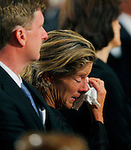 Boston, MA - August 29, 2009 -- Kara Kennedy Allen wipes away tears as she and her brother Congressman Patrick Kennedy (L) and her father's widow Vicki Reggie Kennedy (R) listen to her brother Edward Kennedy Jr. offer remembrances of their father during. during funeral services for U.S. Senator Edward Kennedy at the Basilica of Our Lady of  Perpetual Help in Boston, Massachusetts August 29, 2009.  Senator Kennedy died late Tuesday after a battle with cancer.    .Credit: Brian Snyder- Pool via CNP