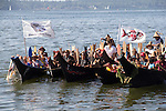 Canoe Journey, Paddle to Nisqually, 2016, Northwest tribal canoes l-r Cowlitz Tribe, Chinook Nation, Naya Canoe Family, Confederated Tribes of the Warm Springs Reservation arriving in Olympia, Washington, 7-30-2016, Salish Sea, Puget Sound, Washington State, USA,