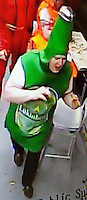 COPY BY TOM BEDFORD<br /> Pictured: CCTV still of a man dressed as a beer bottle that South Wales Police want to speak with.<br /> Re: A man dressed as a beer bottle is being sought by police after allegedly helping himself to two pizzas without paying.<br /> Police are looking to identify the reveller who was caught on CCTV at a branch of Papa Johns in Barry on New Year's Day.<br /> He is said to have entered a staff-only area and helped himself to the pizzas and left without paying.<br /> Anyone who recognises him should call the police