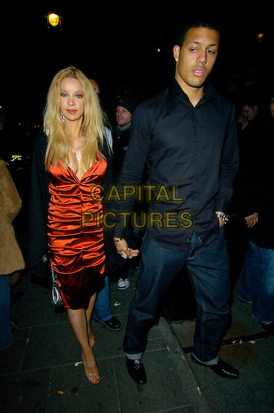 ALICIA DUVALL & GUEST.Attending the Children In Need Fundraiser Party at Embassy Club, London, England, 16th November 2007..full length red satin ruched dress holding hands.CAP/CAN.©Can Nguyen/Capital Pictures