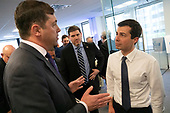Shai Franklin, longtime foreign policy for the Jewish organizational operative, speaks with Mayor Pete Buttigieg after he spoke with leaders of the Jewish community at a communal parlor meeting at the offices of Bluelight Strategies in Washington D.C., U.S. on May 23, 2019.<br /> <br /> Credit: Stefani Reynolds / CNP