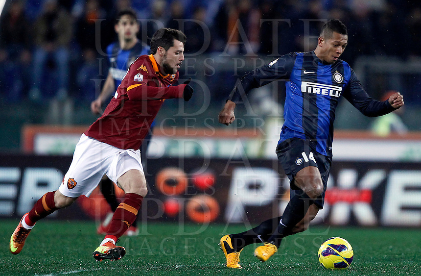 Calcio, semifinale di andata di Coppa Italia: Roma vs Inter. Roma, stadio Olimpico, 23 gennaio 2013..FC Inter midfielder Fredy Guarin, of Colombia, is chased by AS Roma forward Mattia Destro, left, during the Italy Cup football semifinal first half match between AS Roma and FC Inter at Rome's Olympic stadium, 23 January 2013..UPDATE IMAGES PRESS/Isabella Bonotto