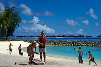 U.S. defense contractors and military soldiers and their families enjoy the beach on the U.S. Army base on Kwajalein, part of the Ronald Reagan Ballistic Missile Defense Test Site, in the Marshall Islands on June 24, 2012. Around one-thousand American defense contractors and soldiers live on Kwajalein. With its tropical weather and facilities including a golf course, baseball fields, multiple swimming pools and beaches, the base is often compared to a country club by U.S. defense personnel.