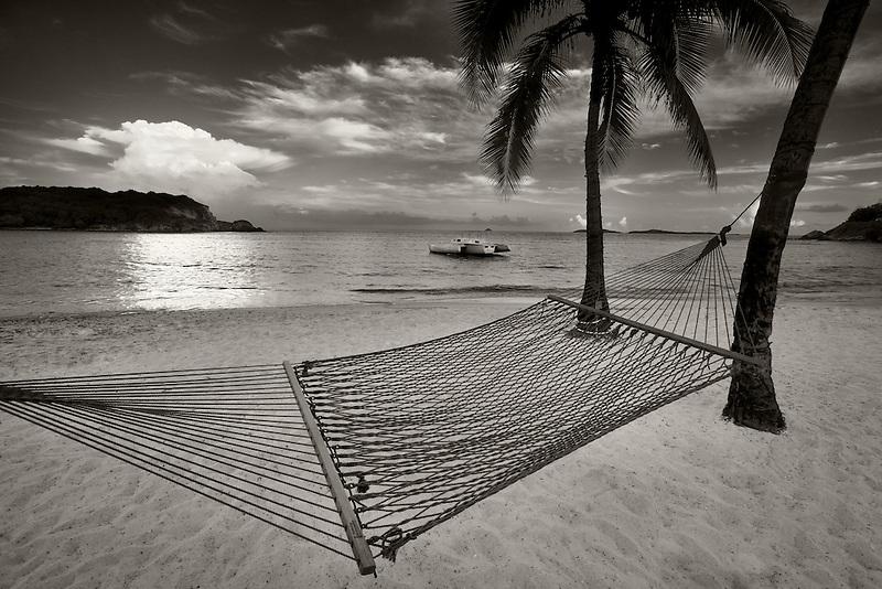 Hammock and sunset at Bolongo Bay Beach. St. Thomas. US Virgin Islands.