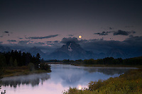 Moon over Oxbow Bend at sunrise in Grand Teton National Park