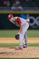 North Carolina State Wolfpack relief pitcher Tommy DeJuneas (42) looks to his catcher for the sign against the Charlotte 49ers at BB&T Ballpark on March 31, 2015 in Charlotte, North Carolina.  The Wolfpack defeated the 49ers 10-6.  (Brian Westerholt/Four Seam Images)