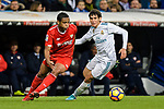 Luis Muriel of Sevilla FC (L) fights for the ball with Jesus Vallejo of Real Madrid (R) during La Liga 2017-18 match between Real Madrid and Sevilla FC at Santiago Bernabeu Stadium on 09 December 2017 in Madrid, Spain. Photo by Diego Souto / Power Sport Images