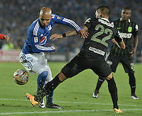 BOGOTA - COLOMBIA -31 -03-2016: Jonathan Estrada (Izq) jugador de Millonarios disputa el balón con Gilberto Alcatraz Garcia (Der.) jugador de Nacional, durante partido aplazado de la fecha 9 entre Millonarios Atletico Nacional, de la Liga Aguila I-2016, jugado en el estadio Nemesio Camacho El Campin de la ciudad de Bogota.  / Jonathan Estrada (L) jugador of Millonarios vies for the ball with Gilberto Alcatraz Garcia (R) player of Nacional, during a postponed match between Millonarios and Atletico Nacional,  for the date 9 of the Liga Aguila I-2016 at the Nemesio Camacho El Campin Stadium in Bogota city. Photo: VizzorImage / Gabriel Aponte / Staff.