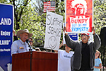 Counter-protester Tork Rains, right, moves through as Clive Bundy speaks at a rally challenging federal control of Nevada public lands outside the Legislative Building in Carson City, Nev., on Tuesday, March 31, 2015. <br /> Photo by Cathleen Allison