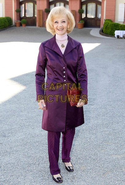 LISELOTTE LILO LENHOFF.Marriage of Count Bjorn Bernadotte of Wisborg & Countess av Sandra (born Angerer), Castle Church of St. Mary, Isle of Mainau in Lake Constance. .May 7th, 2009 .wedding full length purple jacket trousers .CAP/PPG/JH.©Jens Hartmann/People Picture/Capital Pictures