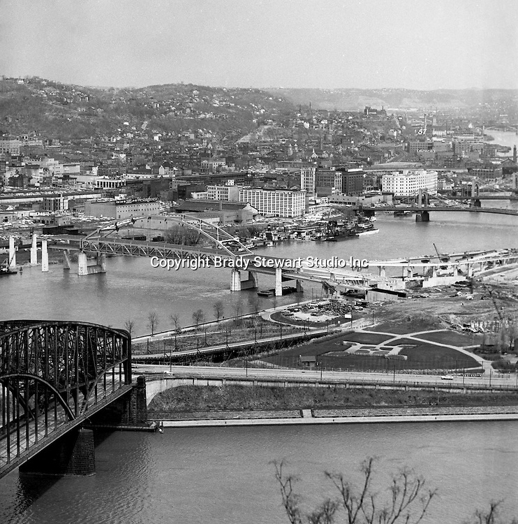 Pittsburgh PA:  View of the Fort Duquesne Bridge construction and Northside from Mount Washington - 1962.  Fort Duquesne Bridge and Point State Park under construction.