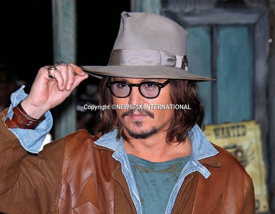 """JOHNNY DEPP.at the premiere of Rango, Regency Village Theater, Los Angeles_14/2/2011.Mandatory Photo Credit: ©M.Philips_Newspix International..**ALL FEES PAYABLE TO: """"NEWSPIX INTERNATIONAL""""**..PHOTO CREDIT MANDATORY!!: NEWSPIX INTERNATIONAL(Failure to credit will incur a surcharge of 100% of reproduction fees)..IMMEDIATE CONFIRMATION OF USAGE REQUIRED:.Newspix International, 31 Chinnery Hill, Bishop's Stortford, ENGLAND CM23 3PS.Tel:+441279 324672  ; Fax: +441279656877.Mobile:  0777568 1153.e-mail: info@newspixinternational.co.uk"""