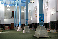Low angle view of main hall, Ulugh Beg Madradsah, 1417-20, Registan, Samarkand, Uzbekistan, pictured on July 15, 2010, in the morning. Pale blue columns adorn the simple white hall. Samarkand, a city on the Silk Road, founded as Afrosiab in the 7th century BC, is a meeting point for the world's cultures. Its most important development was in the Timurid period, 14th to 15th centuries. Picture by Manuel Cohen.