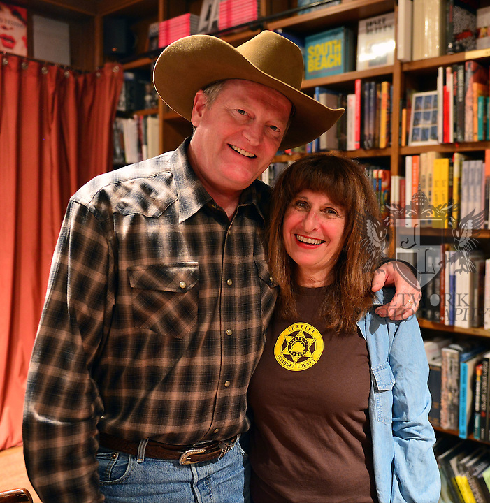 CORAL GABLES, FL - OCTOBER 21: Author Craig Johnson and wife Judy Johnson signs copies of 'Spirit of Steamboat: A Walt Longmire Story' at Books and Books on October 21, 2013 in Coral Gables, Florida. (Photo by Johnny Louis/jlnphotography.com)