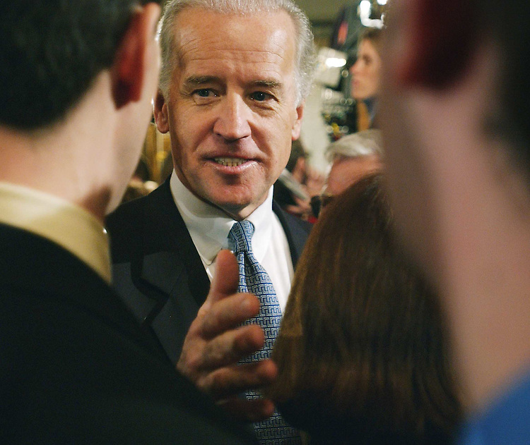 1/28/03.STATE OF THE UNION ADDRESS--Sen. Joseph R. Biden Jr., D-Del., talks to reporters in Statuary Hall after President George W. Bush's State of the Union address at the U.S. Capitol..CONGRESSIONAL QUARTERLY PHOTO BY SCOTT J. FERRELL