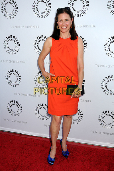 Mimi Rogers.Debbie Reynolds' Hollywood Memorabilia Exhibit Reception Presented by Turner Classic Movies and The Paley Center for Media held at The Paley Center, Beverly Hills, California, USA.June 7th, 2011.full length red orange sleeveless dress hand in pocket black clutch bag shoes blue.CAP/ADM/BP.©Byron Purvis/AdMedia/Capital Pictures.