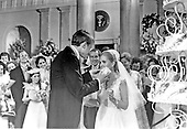 Washington, DC - June 12, 1971 -- Tricia Nixon Cox samples a piece of wedding cake from husband Edward as United States President Richard M. Nixon and first lady Pat Nixon look on at the reception in the East Room of the White House in Washington, D.C. following the wedding ceremony in the Rose Garden on Saturday, June 12, 1971.  .Credit: Pool via CNP