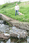 Cllr Frank Gallagher with Miley the Golden Retriever show the rubbish in the waterway in the Glen, Newfoundwell Road...Photo NEWSFILE/Jenny Matthews.(Photo credit should read Jenny Matthews/NEWSFILE)....This Picture has been sent you under the condtions enclosed by:.Newsfile Ltd..The Studio,.Millmount Abbey,.Drogheda,.Co Meath..Ireland..Tel: +353(0)41-9871240.Fax: +353(0)41-9871260.GSM: +353(0)86-2500958.email: pictures@newsfile.ie.www.newsfile.ie.FTP: 193.120.102.198.
