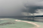 Raja Ampat's sand cay about to get a downpour of rain..