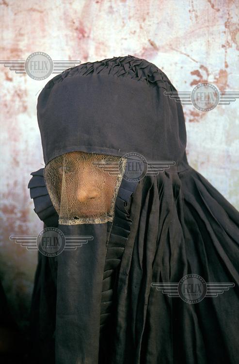 ©Liba Taylor / Panos Pictures..Bangladesh..Burmese Muslim woman wearing a burqa.