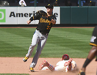 25th July 2020, St Louis, MO, USA;  St. Louis Cardinals center fielder Harrison Bader steals second as Pittsburgh Pirates infielder Kevin Newman (27) leaps for the throw during a Major League Baseball game between the Pittsburgh Pirates and the St. Louis Cardinals