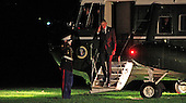 United States President Barack Obama salutes the Marine Guard as he returns to the White House on October 20, 2014.<br /> Credit: Dennis Brack / Pool via CNP