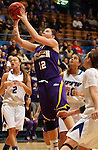 SIOUX FALLS, SD - MARCH 10:  Jackie Rieger #12 from Western Illinois lays the ball up past Rachel Mauk #2, Haley Seibert#10 and Amanda Hyde #11 from IPFW in the second half of their quarterfinal game Sunday afternoon at the 2013 Summit League Championships in Sioux Falls, SD.  (Photo by Dave Eggen/Inertia)
