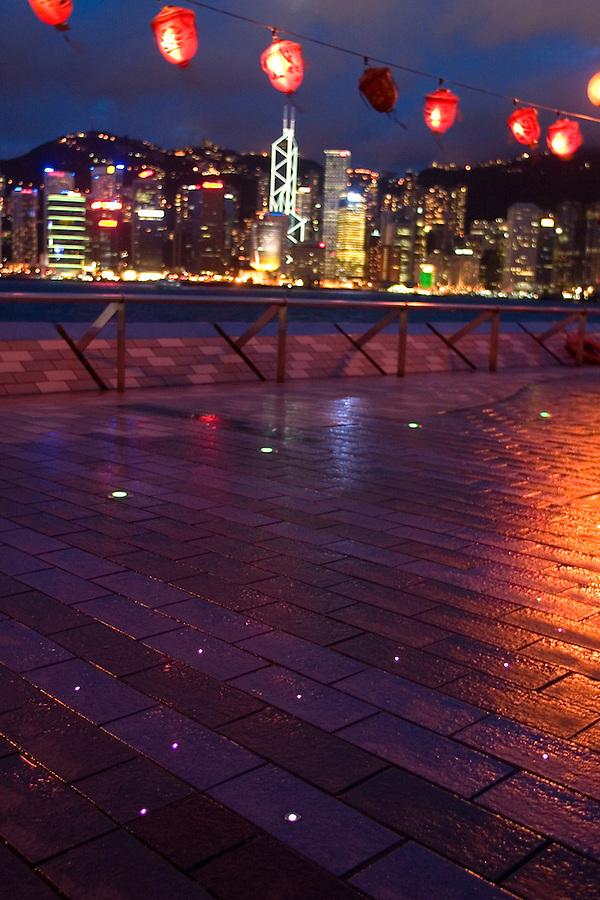 LED lights embedded in sidewalk and lanterns frame Hong Kong skyline, Avenue of the Stars, Tsim Sha Tsui Promenade, Kowloon waterfront, Hong Kong SAR, China, Asia