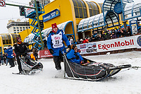 Aliy Zirkle and team leave the ceremonial start line with an Iditarider and handler at 4th Avenue and D street in downtown Anchorage, Alaska on Saturday March 7th during the 2020 Iditarod race. Photo copyright by Cathy Hart Photography.com