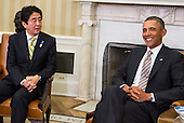 United States President Barack Obama, right, meets Prime Minister Shinzo Abe of Japan, left, during a photo-op in the Oval Office of the White House in Washington, D.C. following a bilateral meeting between the two leaders on Friday, February 22, 2013. .Credit: Kristoffer Tripplaar  / Pool via CNP