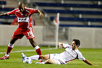 New England Revolution defender Jay Heaps (6) slide tackles the ball away from Chicago Fire forward Andy Herron (26).  The Chicago Fire defeated the New England Revolution 2-1 in the quarterfinals of the U.S. Open Cup at Toyota Park in Bridgeview, IL on August 23, 2006...
