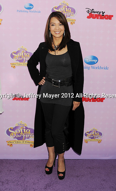 "BURBANK, CA - NOVEMBER 10: Ming Na  arrives at the Disney Channel's Premiere Party For ""Sofia The First: Once Upon A Princess"" at the Walt Disney Studios on November 10, 2012 in Burbank, California."