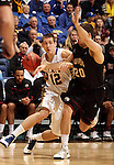SIOUX FALLS, SD - MARCH 9:  Brayden Carlson #12 from South Dakota State University tries to drive past Sean Esposito #20 from IUPUI in the first half of their game Saturday evening at the 2013 Summit League Basketball Championship. (Photo by Dave Eggen/Inertia)
