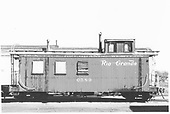 Side view of caboose #0589 with one window boarded up.<br /> D&amp;RGW