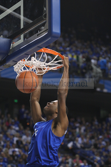 Guard Andrew Harrison dunks the ball during the second half of the Blue-White Scrimmage at Rupp Arena on Monday, October 27, 2014 in Lexington, Ky. Photo by Adam Pennavaria | Staff