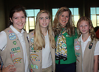 NWA Democrat-Gazette/CARIN SCHOPPMEYER Girl Scouts Anna Clair Tilley (from left), Paxton Splittorff, Dawn Prasifka, Girl Scout Diamonds president and chief executive officer, and Nyah Hostler represent the organization at the AFP luncheon, where they were presented the Youth in Philanthropy group award.